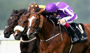 Gold Cup Winner Leading Light (purple silks). Image credit @Channel4Racing