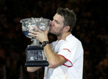Stanislas Wawrinka of Switzerland poses with the Norman Brookes Challenge Cup after defeating Rafael Nadal of Spain in their men's singles final match at the Australian Open 2014 tennis tournament in Melbourne