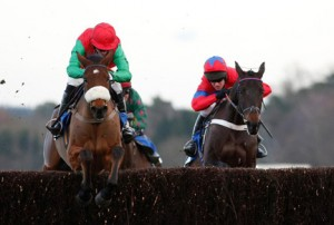 Dodging Bullets (white noseband) forges ahead of Sprinter Sacre. Image credit @Channel4Racing