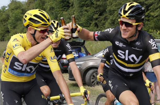 Britain's Chris Froome, wearing the overall leader's yellow jersey, and his Sky teammate Geraint Thomas toast with bottles of beer during the twenty-first stage of the Tour de France cycling race over 113 kilometers (70.2 miles) with start in Chantilly and finish in Paris, France, Sunday, July 24, 2016. (AP Photo/Christophe Ena)