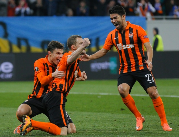 10 Mar 2016, Kiev, Ukraine --- epa05204896 Shakhtar players celebrate after Olexandr Kucher (C) scored a goal during the UEFA Europa League round of 16, first leg soccer match between Shakhtar Donetsk and Anderlecht at the Arena Lviv stadium in Lviv, Ukraine, 10 March 2016. EPA/SERGEY DOLZHENKO --- Image by © SERGEY DOLZHENKO/epa/Corbis